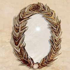Truly spectacular! Oval wood frame and real deer antler mirror. Sheds from whitetail, mule deer or black tail deer are used to create each one of kind masterpiece. Each mirror is hand made to match th