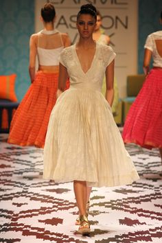 Anita Dongre.  I like the low revealing top against the modest full bottom of the dress.