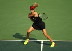Eugenie Bouchard of Canada plays a backhand during the Women's Singles second round match against Angelique Kerber of Germany on Day 3 of the Rio 2016 Olympic Games at the Olympic Tennis Centre on August 8, 2016 in Rio de Janeiro, Brazil. (Source: Clive Brunskill/Getty Images South America)