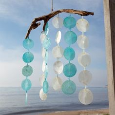 Inspiration for diy faux capiz mobile on driftwood.