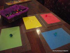 Sticky Paper Colour Matching Game...a fun and frugal activity for toddlers as they explore the beginnings of colour recognition and matching!