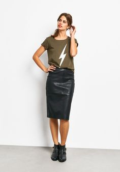 """This beautifully soft black leather pencil skirt will be an investment piece for seasons to come. Wear it with your favourite jumper and ankle boots for a chic look. • Sits just on or below the knee depending on height. Tailored with slight stretch. • Panelled with a back split. • Exposed back zip. • Centre back length 65.2 cm (size 10) • Model is 5'9"""" and wears size 10."""