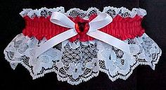 Party Time. A Red Rhinestone Heart is the center of attraction for this Garter on white lace with a red satin band. Style # WV-250 / Visit: www.garters.com/page13c.htm