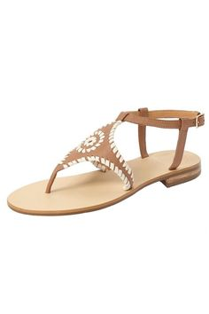 c909b8169 A whipstitched leather strap highlights a sleek flat sandal that makes a  trend-savvy update. Shoptiques