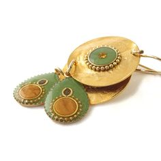 Gold Earrings Dangle Green Drop hanging on a by @SigalitAlcalai