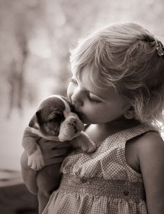 Puppy kisses, that little girl has found her best friend