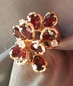 One ladies yellow gold 14k ring with 9 pear-shaped red garnet stones. #Cluster