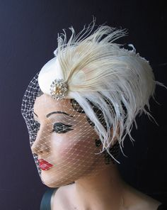 Beautiful hat with white peacock feathers for the bride @Alyssa Manreno