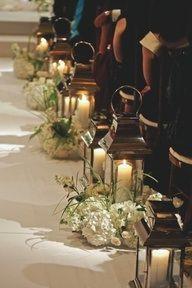 Church wedding ceremony. Lanterns with wedding color flowers