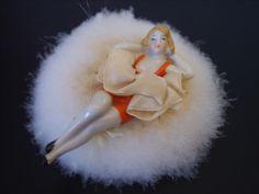 Swansdown bathing belle half doll powder puff.