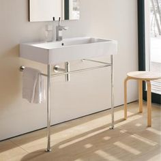 Duravit basin with chrome legs and towel rail