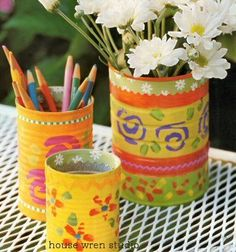 Coffee cans make great organizers for pens, pencils, school supplies, etc. Lots of possibilities here!