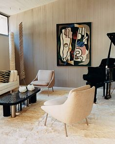 Mid-Century Modern. The music room is decorated with mid-twentieth-century furnishings and toned down with textured materials, such as a Tibetan goatskin rug from Minassian's Paris shop; the 1930s Cubist painting is by Georges Valmier