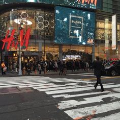 Pin for Later: If You Survived Balmain x H&M, This Is What You Saw In Times Square, the Line Stretched Around the Block