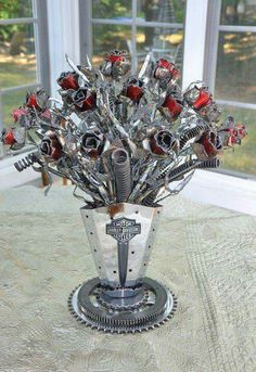 Vase of flowers made entirely of motorcycle parts