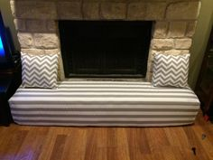 Fireplace cover - child proofing the stone hearth Gray and white stripes and Chevron print pillows Homemade!