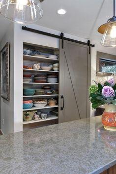 sleek gray pantry barn door