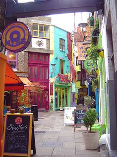 London, off the beaten path...Neal's Yard, Covent Garden, London. Neal's Yard is a small alley in Covent Garden between Shorts Gardens and Monmouth Street which opens into a courtyard. It is named after the 17th century developer, Thomas Neale. It now contains several health food cafes and new age retailers that are all painted in a variety of colors.