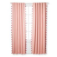 Get uninterrupted rest during daylight hours with the Tassel Lightblocking Curtain Panel from Pillowfort. This solid curtain panel with colorful tassels along the edge has a rod pocket for easy hanging.