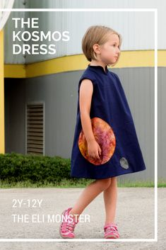 Abstracted into the simplest shapes, this space dress sewing pattern features an integrated standing collar and cap sleeves add some POP while keeping with the streamlined design. 2 planets (or a planet and a moon) are uniquely added to the dress and wrap around to the back.
