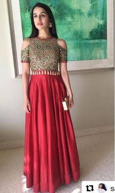 Aesthetically Amazing... Plain red skirt with a heavily embroidered top and statement earrings is so marvellous. The cold shoulder detail adds to the look as does the clutch.... Shop the similar look at https://www.estrolo.com/whatstrending/Aesthetically-amazing/