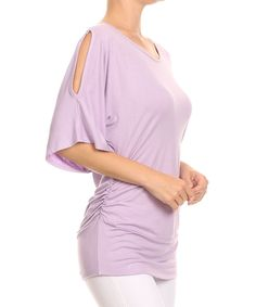 This charming feminine top features a gentle, draping fit, hugging the waist for a flattering profile. Chic cutouts at the shoulders add on-trend flair.Size S: 27'' long from high point of shoulder to hem93% rayon / 7% spandexHand washMade in the USA