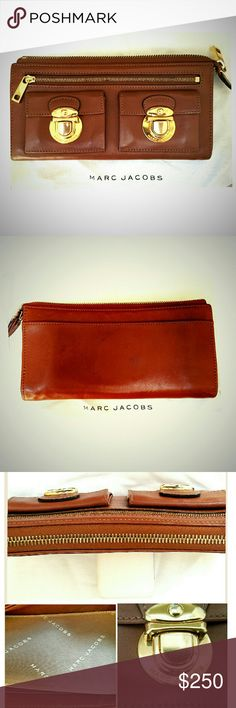 """Marc Jacobs Original Push Lock Clutch Wallet STUNNING brown leather wallet/clutch from Marc Jacobs. Currently sold out everywhere. Measures approximately 8"""" x, 4"""" x 1"""". 2 push-lock pockets engraved """"Marc Jacobs"""" & 1 zippered compartment on the front. 1 open pocket on the back. Zipper across the top leads to spacious interior w/ 4 pockets & 12 card slots. Wallet is in pristine condition w/no mentionable wear. All brass hardware is stamped """"Marc Jacobs"""". Rare, sold-out, original Marc Jacohs…"""