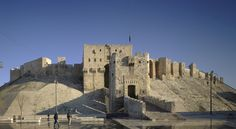 Citadel of Aleppo.  Bridge tower as seen from the paved pedestrian plaza | The site has been greatly damaged in recent fighting | Archnet