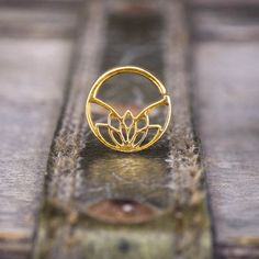 Lotus Septum Ring, Gold Septum, Indian Septum Ring, Tribal Septum, Gold Nose Ring, Septum Jewelry, Septum Piercing 18g  Lotus septum ring In 18k yellow gold plated for pierced nose- 18g septum ring. For: Septum, Nose, Cartilage, Tragus, Helix, Rook, Nipple, lobe & bellybutton piercing.  ↠Material: Made from 18k gold plated (2 micron) over sterling silver. Nickel free ✔️ Durable and long lasting ✔️  ↠Available in 18 gauge.  ↠Diameter measurements: side to side-