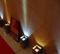 Tissue boxes with flashlights as spotlights.