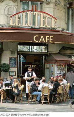 I love to sit in a sidewalk cafe in Paris