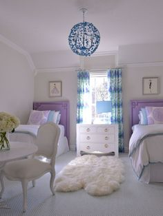 Beautiful cool color scheme. Nailhead upholstered headboards and a fun light fixture add the right amount of liveliness to the room http://www.hardenburgdesigns.com/