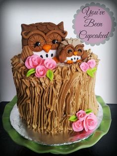 Owl baby shower cake. Beautiful tree stump cake with owls and pretty, pink flowers. Would be ideal for a woodland or owl themed birthday party or baby shower. So pretty!