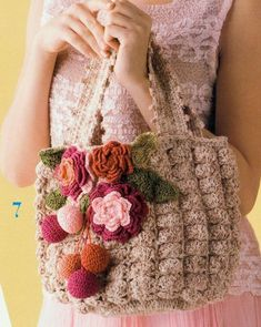 Interesting crochet stitched bag embellished with flowers. Diagram only.