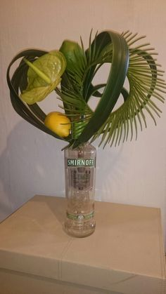 Imitation lime green vodka anthurium floral design made by the floral emporium. SOLD