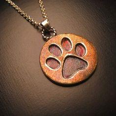Sterling silver paw print pendant with my secret silver patina. @norwoodsofnashville #nashville #norwoodsofnashville #silver #pendant #animal #jewelry #pawprint