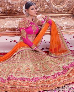 Cream orange and pink lehenga with zari resham sequins heavy embroidery all over 1. Cream orange and pink art silk heavy embroidered lehenga2. Heavy Zari, resham embroidery with stone work with embroidery butta and lace border3. Comes with matching dupatta4. Can be stitched upto size 44 inches