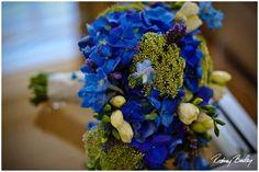 Blue hydrangea, delphinium, queen anne's lace, white freesia and lavender