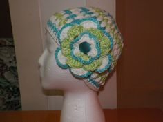 I made this 100% cotton variegated yarn hat this week. The flower is optional. It is glued onto a very sturdy beautician clip, so will clamp into very thin hair easily, and stay in place. It will be available at Thrifty Sisters, a store in Charleston, Oregon, along with many more of my hats and creations.