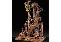 Belén Napolitano Nápoles Siglo XVIII 20 Figuras Terracota modelada, madera talla, estopa y tejidos originales 120 x 100 x 80 cm
