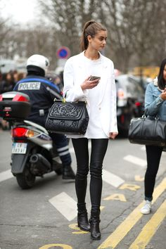 Taylor Hill | white blazer + oversized shirt + leather pants + black Dolce and Gabbana large bag + black ankle boots