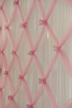 Create a backdrop by making lattice out of tulle.