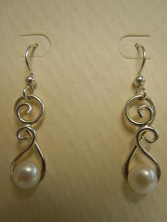 Sterling Wire Formed Pearl Dangle Earrings. $20.00, via Etsy.