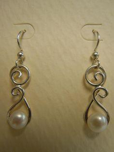 Sterling Wire Formed Pearl Dangle Earrings. $20.00, via Etsy.