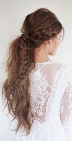 Loose, natural half up-do with french braid. One of the perfect choices for bohemian brides with long, wavy hair.