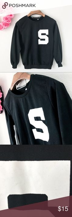 """""""S"""" Logo Black Sweater Top Pre-loved but in great condition. Doesn't show signs of wear. """"S"""" Logo has some lint Hugging it. See pic. Cute none the less. (0265)   PRODUCT DETAILS: •Size: Small •Colors: Black, White •Made in China •Measurements: Chest-18inch Length-24inch •Material: Unknown •Long Sleeve •Crew / Scoop Neck •Thin Sweater Top Style •Hugs around wristband hips •Displays """"S"""" Logo  Tags: blouse shirt winter fall Simple everyday school Sweaters Crew & Scoop Necks"""