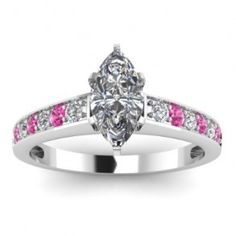 Marquise & Pink Sapphire Cut Diamond Engagement Ring - A fantastic combination of impressive stones comes with this 14k White Gold Marquise & Pink Sapphire Cut Diamond Engagement Ring placed in a Micro Pave setting featuring a White Marquise cut center stone with 12 White & Pink Sapphire accent stones. The Marquise & Pink Sapphire Cut engagement ring comes with a VS1 in clarity as well as a D in color. The gem weight is equal to .55 carats. The diamonds are 100% natural. #unusualengagementrings