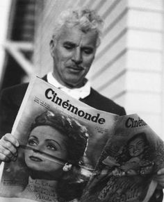 Aged Charlie Chaplin reading a French magazine
