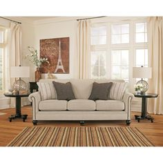 Upholstered in neutral linen-tones, this elegant Milari sofa features classic rolled arms studded with nailhead trim, plush cushions and sturdy bun feet. Blending comfort and elegant, enjoy the luxurious feel of this Milari sofa with a sleeper option.