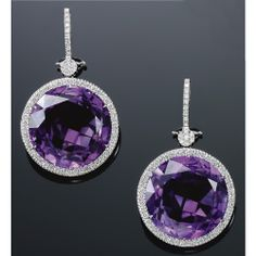PAIR OF AMETHYST AND DIAMOND EAR PENDANTS, MICHELE DELLA VALLE Each set with a circular-cut amethyst within a border of brilliant-cut diamonds, suspended by a similarly-set surmount, clip and post fittings, maker's marks for Michele Della Valle.